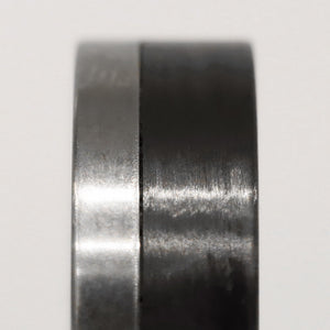 A titanium ring with carbon fiber sidelay
