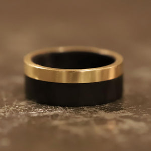 A carbon fiber and gold men's engagement ring