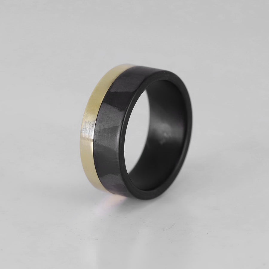 14 karat yellow gold ring with carbon fiber