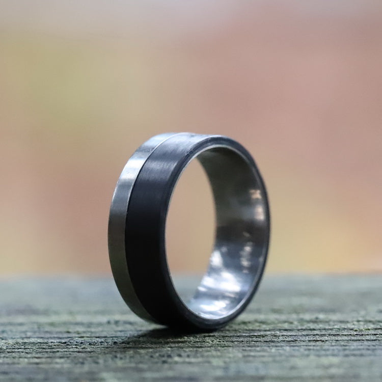 An aerospace ring with titanium and carbon fiber