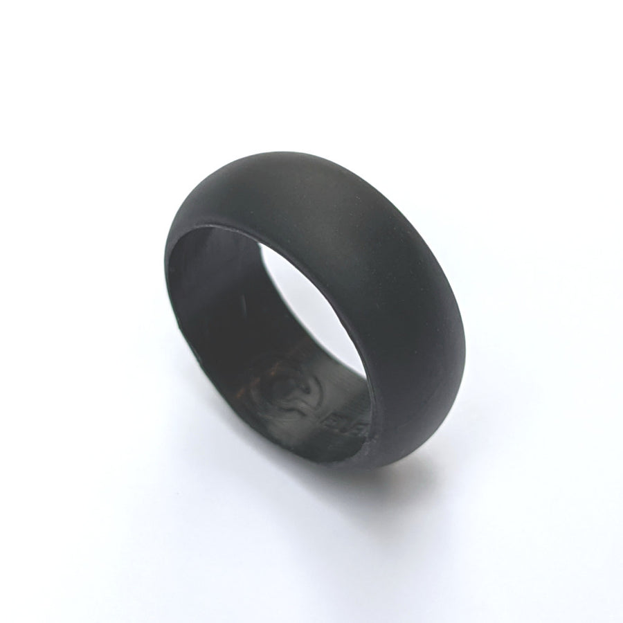 A jet black silicone wedding ring