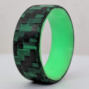 A carbon fiber glowing ring with green glow liner