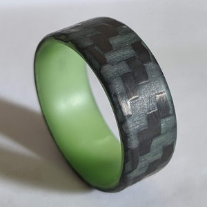 A glowing carbon fiber wedding ring