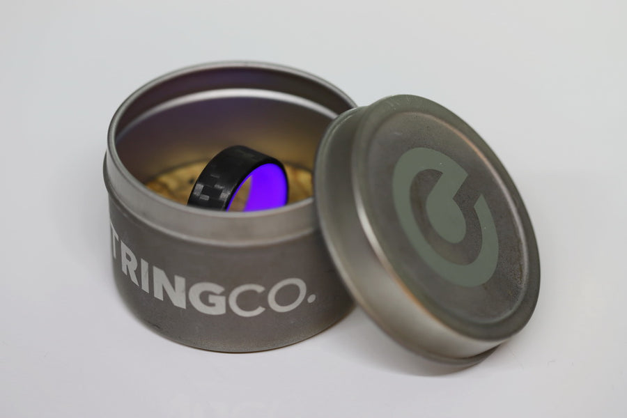 A carbon fiber glow ring in a tin