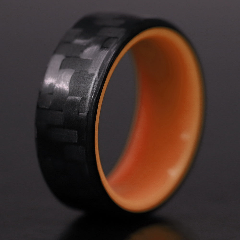 A closeup of an orange carbon fiber ring
