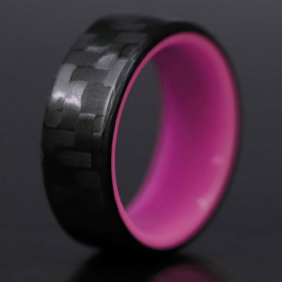 A closeup of the interior of a purple carbon fiber glow ring