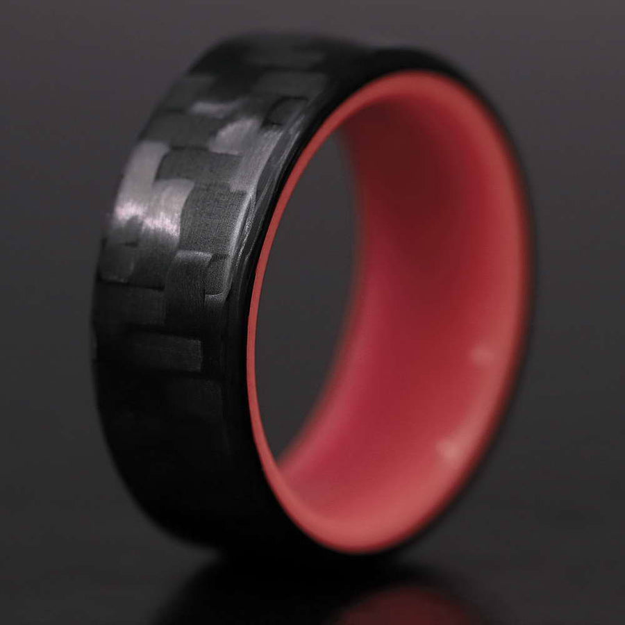A carbon fiber glow ring with a red interior