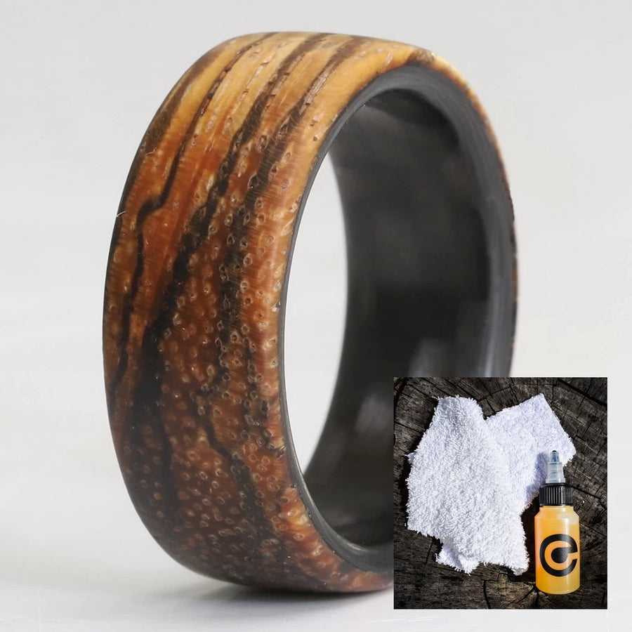 A zebra wood wedding ring and a wood ring care kit