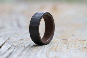 A men's wedding ring with moab sand