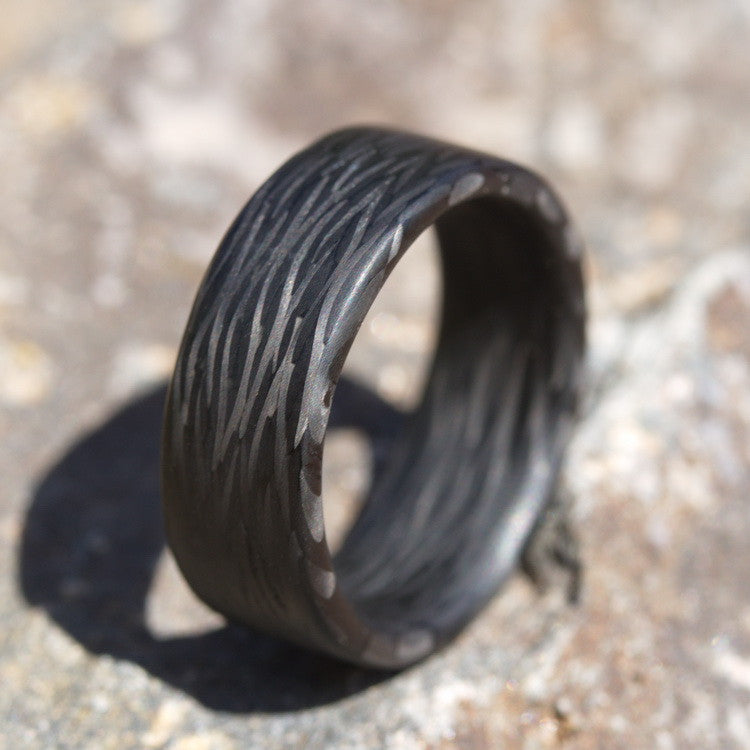 The Wave Carbon Fiber Ring on a sandstone rock