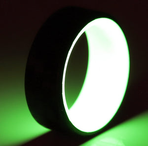 A men's wedding ring with glowing yellow liner