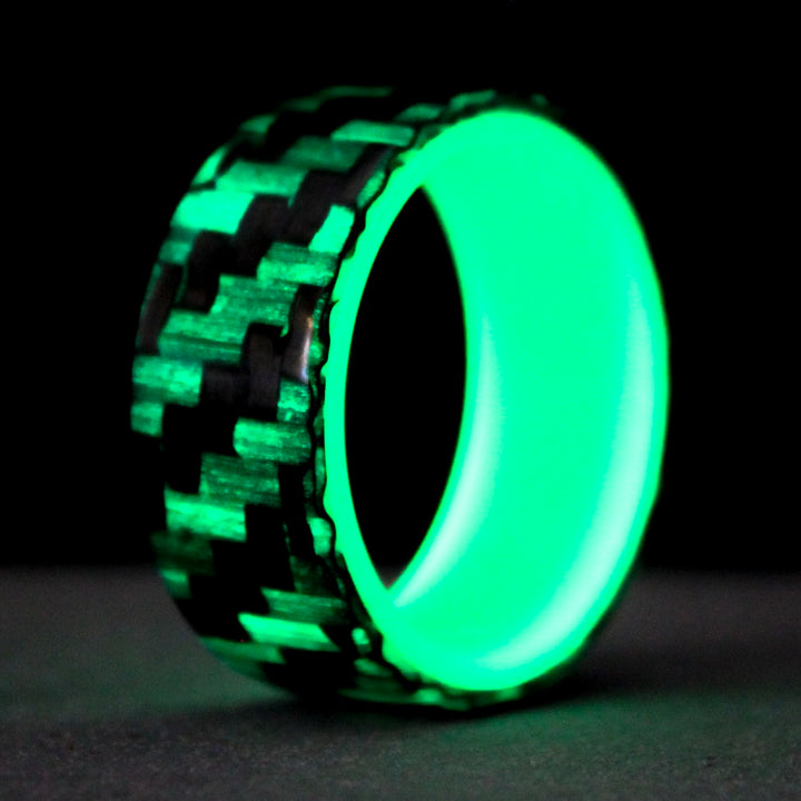 Glowing carbon fiber ring with green glowing liner
