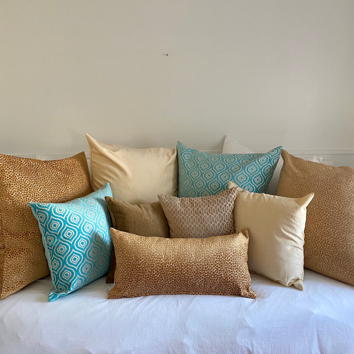 Pile of Pillows in Teal, Gold and Brown