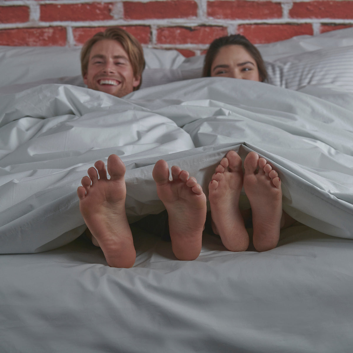 Couple Under Covers with Feet Showing