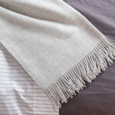 Alpaca Fringe Throw on Bed