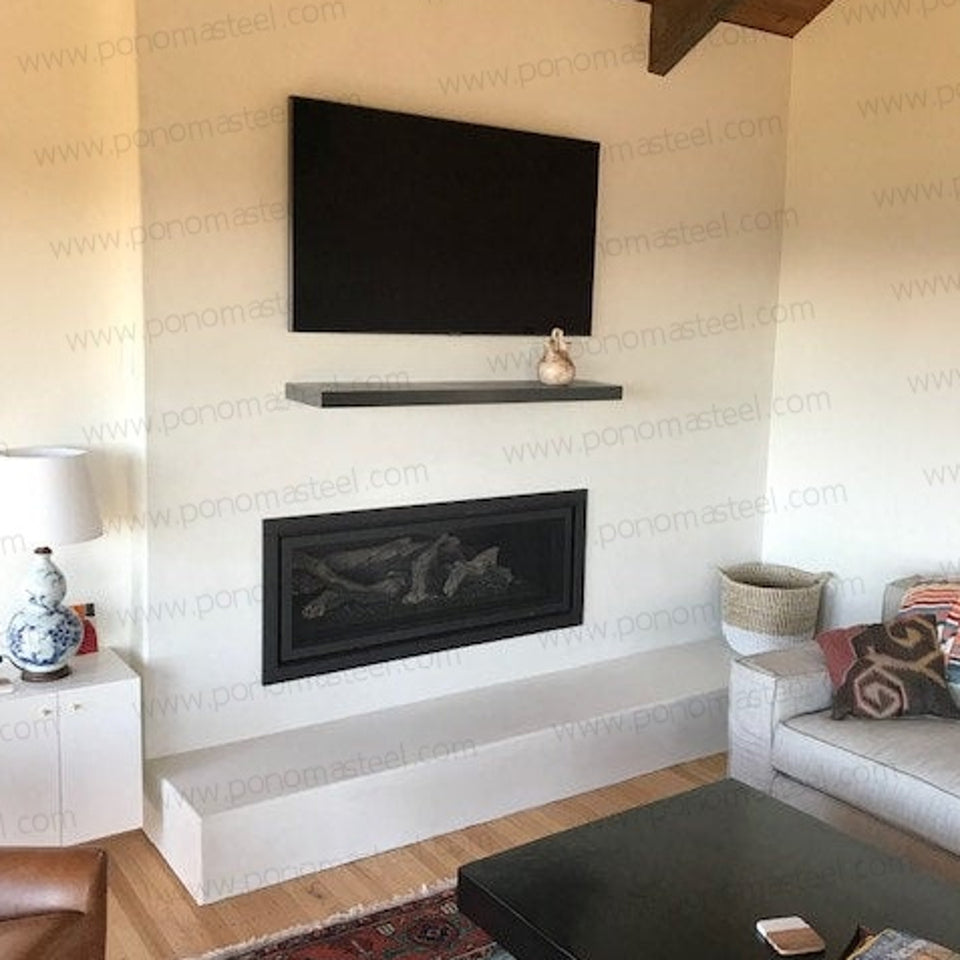 black shelf as a fireplace mantel