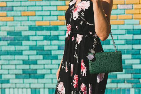 woman wearing dress and has a bag on her arms with luxe link purse hanger