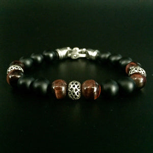 10mm red tigereye, black agate,sterling silver rondells with a stainless steel clasp .