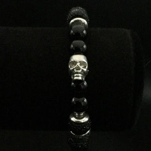 Frosted black onyx beads with a sterling silver skull and black crystals with a stainless steel clasp.