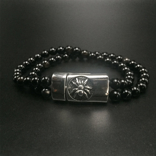 Stainless steel magnetic clasp, with a spider imprint and black striped agate beads.