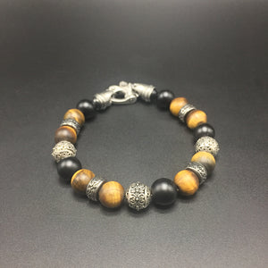tigereye, with accent beads in sterling silver and  stainless steel, with black matted onyx beads and stainless steel clasp.