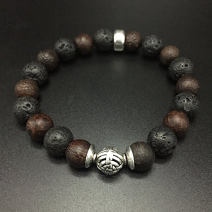 sterling silver center bead with volcanic lava and fossilize stone.