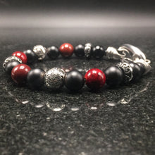 Load image into Gallery viewer, Sterling silver, black agate, yoke stone, and stainless steel clasp.