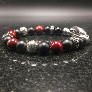 Sterling silver, black agate, yoke stone, and stainless steel clasp.