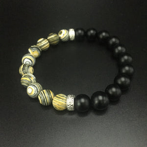 Yellow Malachite with sterling silver Rondell's and Black frosted onyx beads, held together on professional stretch string.