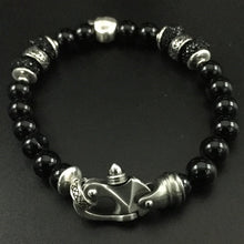 Load image into Gallery viewer, Frosted black onyx beads with a sterling silver skull and black crystals with a stainless steel clasp.