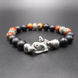 stainless steel clasp, sterling silver Rondels, black matted onyx Beads, and rosewood Abalone Beads