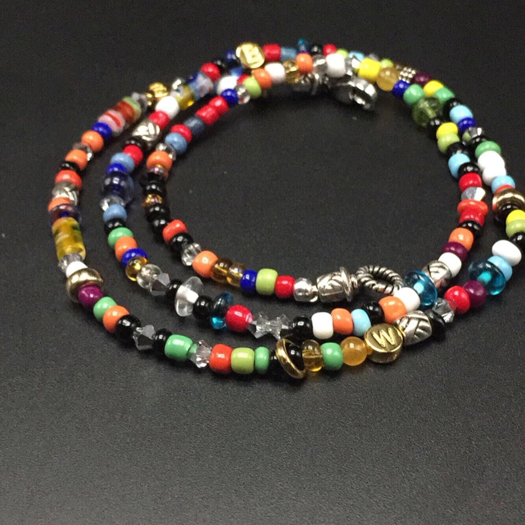 14 karat gold, sterling silver and Swarovski crystals with a playful mix of colored seed beads.