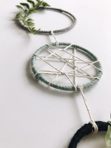 Metallic details on a modern minimalist dream catcher | Bast + Bruin