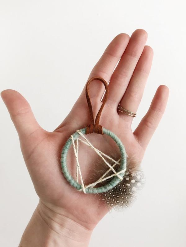 close up of sea foam dream catcher favor