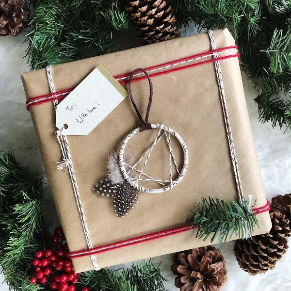 Boho Dreamcatcher Christmas Ornament shown as a holiday package accessory
