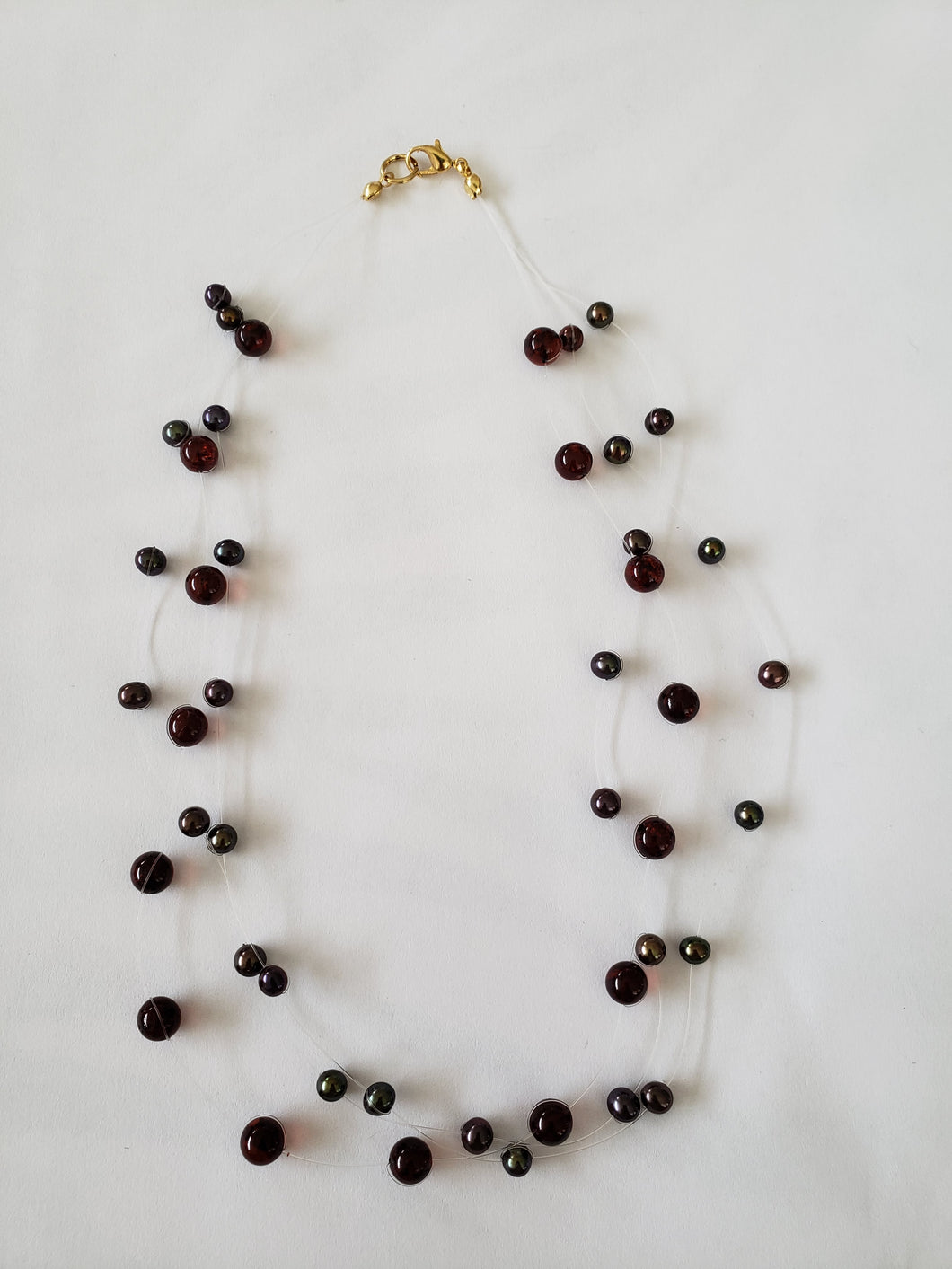 Lee Sands Innlutsion Necklace Styled with Amber & Pearl