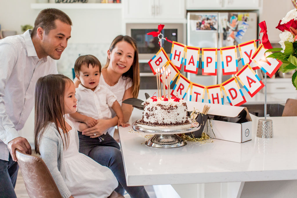 Family celebrates Happy Birthday with Birthday Butler party kit
