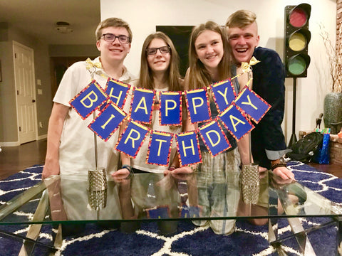 17th birthday with birthday banner and friends