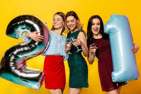 women celebrating 21st milestone birthday party