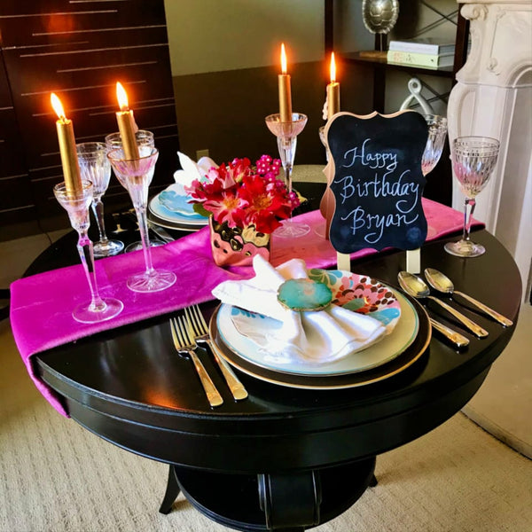 dining table centerpiece with pink runner