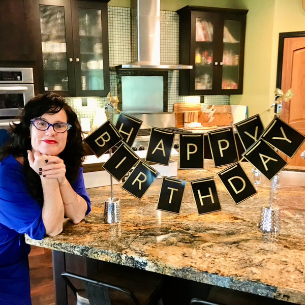 Pretty woman celebrating with a birthday centerpiece from Birthday Butler