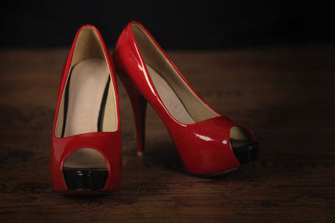 Red high heels from a birthday party for a man turning 50