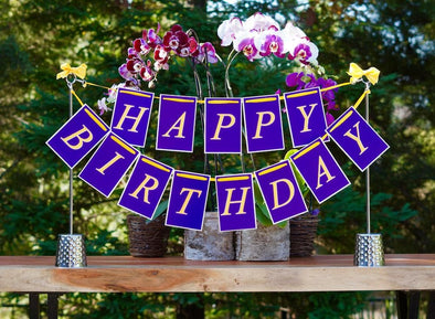 Elegant birthday centerpiece in purple decorations she'll love