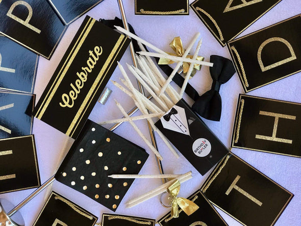 Close-up black and gold decorations for birthday girl