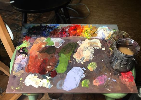 New Wave handcrafted POSH wood table top artist paint palette covered in oil paint in the art studio of Felicia Forte