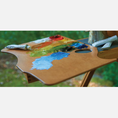 New Wave Handcrafted Maple Wood Highland Ergonomic Hand Held Landscape Artist Paint Palette with oil paint outdoors on a landscape pochade box