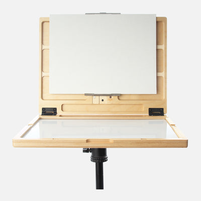 "u.go Plein Air Anywhere Pochade Box, 11"" x 14.5"" model, on tripod with a canvas panel"