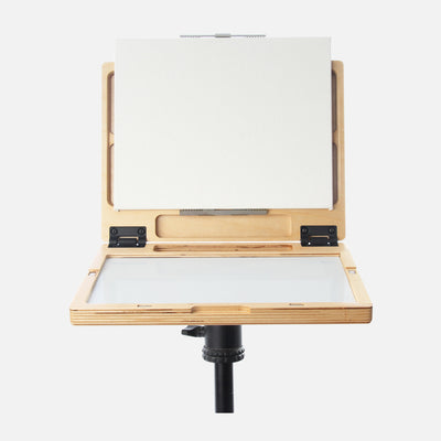 "u.go Plein Air Anywhere Pochade Box, 8.4"" x 11.25"" model, on tripod with canvas panel"