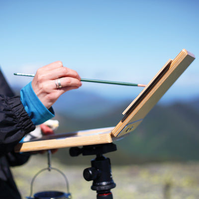 "u.go Plein Air Anywhere Pochade Box, 6"" x 8"" model, on tripod outdoor side view"