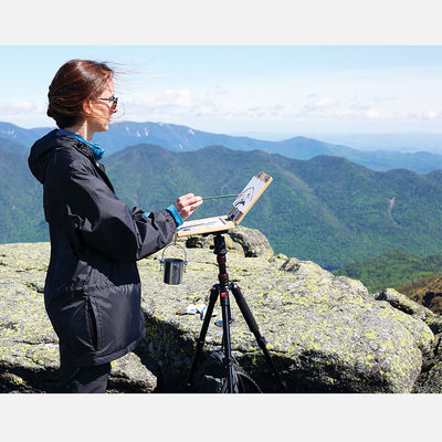 "u.go Plein Air Anywhere Pochade Box, 6"" x 8"" model, on tripod plein air painting on a mountain peak"